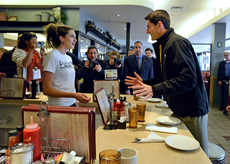Vice presidential candidate Paul Ryan orders cinnamon rolls from waitress Kelly Dones, left, Monday at Johnson's Corner before speaking to a crowd Monday outside the restaurant and truck stop in Johnstown.