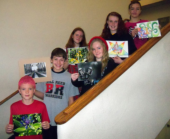 Students from Bill Reed Middle School show off their artwork that will be published in a distric calendar.