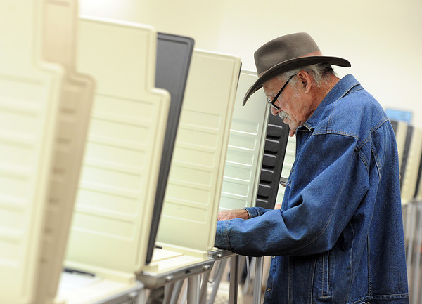 Roger Thimmig of Loveland votes Tuesday at the Loveland Police and Courts building.
