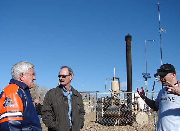 Sierra Club researcher Shane Davis, right, tells Loveland City Manager Bill Cahill and Mayor Cecil Gutierrez about the hazards resulting from emissions at a natural gas well located within a city park in Frederick in southern Weld County.