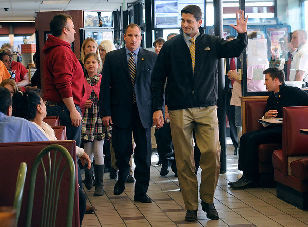 Vice presidential candidate Paul Ryan waves to folks at Johnson's Corner as he walks towards the counter to buy some of their famous cinnamon rolls before speaking to a crowd Monday in Johnstown.