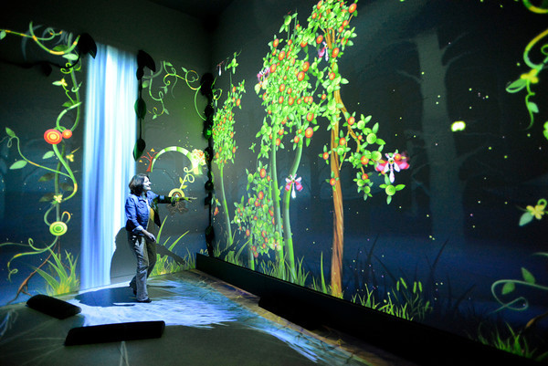 Annette Geiselman, co-executive director at the new Fort Collins Museum of Discovery, plays in the Funky Forest, one of the many interactive experiences at the museum, on Thursday. The museum's grand opening is Saturday.