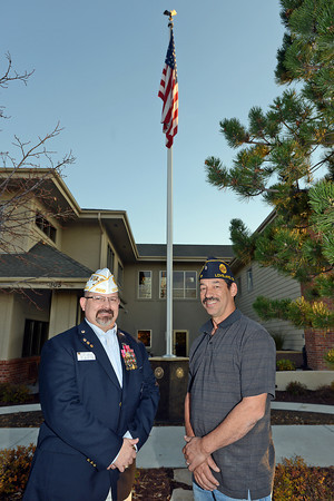 Military veterans Robb D. Smith, left, and Tony DuMosch pose together Wednesday, Nov. 7, 2012 in front of the recently completed Honoring Veterans Tribute Garden at Pathways Hospice. Veterans at the Fort Collins facility are honored with a certificate of appreciation and special pin for Veterans Day.