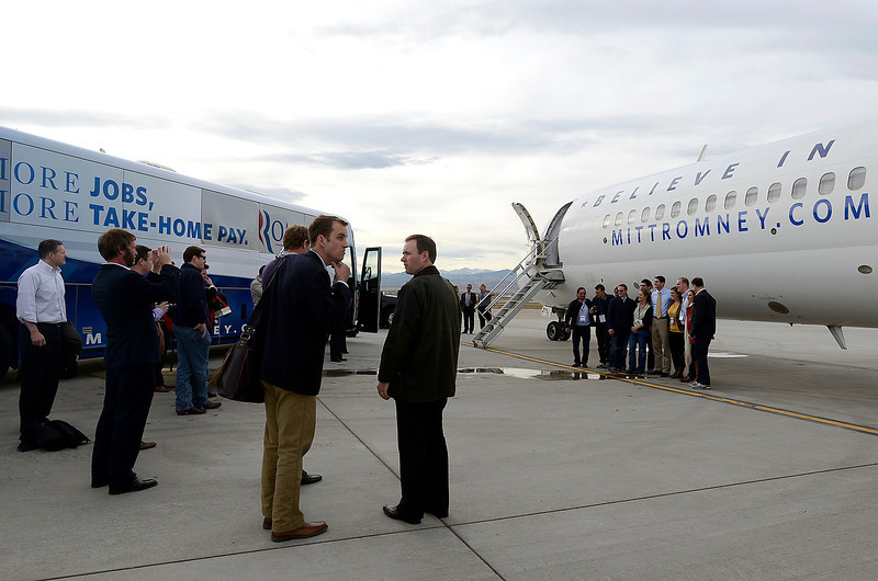 Vice presidential candidate Paul Ryan, far right, poses for a photo with some of the members of the traveling press Monday at the airport in Loveland after making a campaign stop in Johnstown.