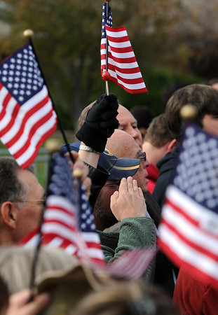 1102 NWS Ryan6-js.jpg A man salutes during the Pledge of Allegiance Thursday during a campaign stop for vice presidential candidate Paul Ryan in Greeley.