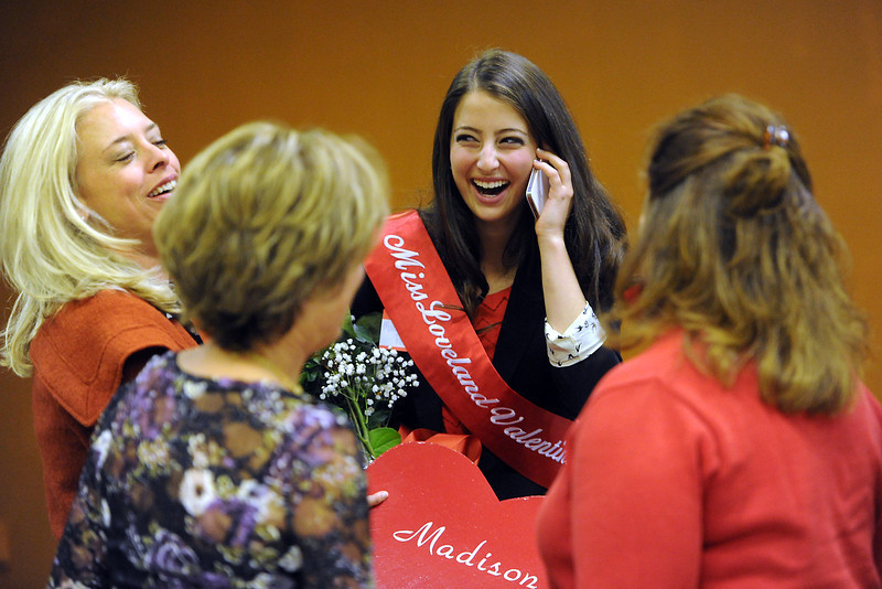 Madison Polansky, back, calls her dad, John Polansky, after being named Miss Loveland Valentine for 2013 during a luncheon with the Thompson Valley Rotary on Thursday, Nov. 1, 2012 in downtown Loveland. Front from left are Madison's mother Danielle Polansky, grandmother Sally Brent and family friend Linda Sioux Stenson.