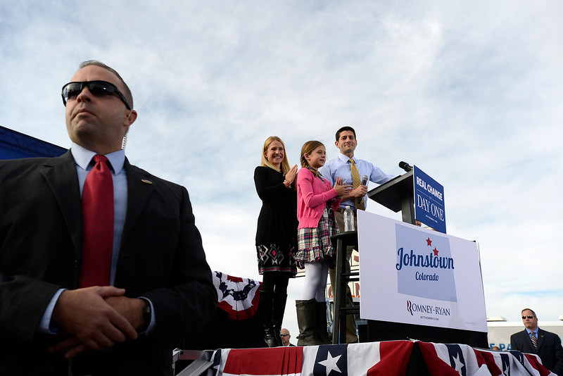 Vice presidential candidate Paul Ryan speaks to a crowd during a campaign stop at Johnson's Corner Monday in Johnstown. His wife, Janna, and daughter Liza, 10, stand by his side.