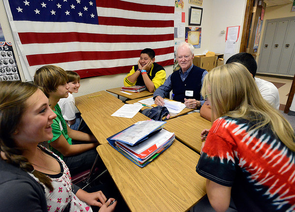 Bill Reed Middle School students work with Rotary Club member Stan Black, center right, as they learn about the 4-way test Thursday during class. Clockwise from left are Jacob Bode, 14, Jeremy Starke, 13, Gwen Altepeter, 13, Makayla Dennis, 14, and Ivan Ramos, 13.