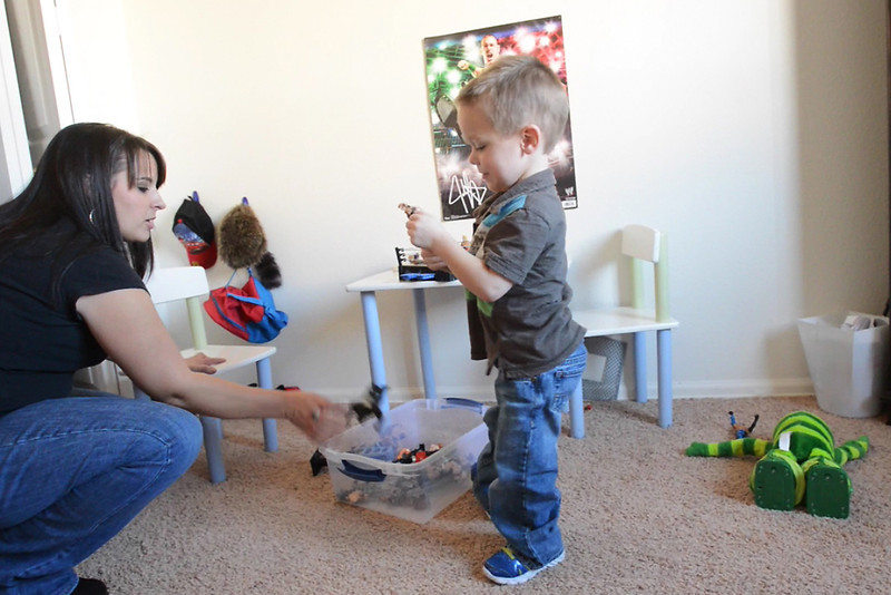 Three-year-old Karter Peterson plays a game with his mother Laurie on Tuesday, Nov. 20, 2012 at their home in Greeley.