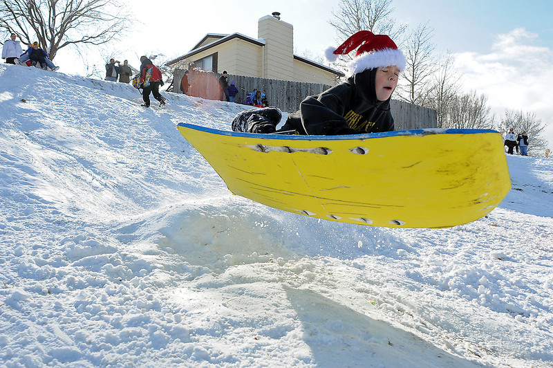 Jeremiah Mattson, 8, of Loveland launches off of a jump on the sledding hill at First Street Southwest and Tyler Avenue on Sunday.