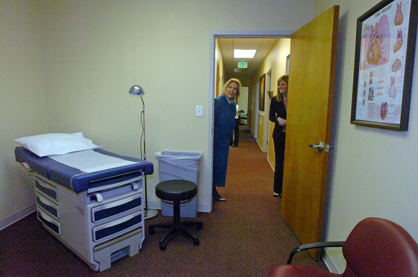 Tami Damiani, right, gives a tour of the new Larimer County Health Clinic to Kathryn Rowe, purchasing director for Larimer County, left, Monday morning in Fort Collins. The clinic is free for county employees in hopes of lowering health care costs and boosting productivity by allowing sick employees to get care right away for free.