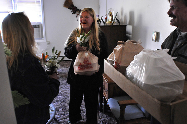 Silver Leaf Resident Evelyn Randall thanks Donna Holtz, left, and Craig Hartig for delivering her a Thanksgiving meal on Thursday. Randall said she probably wouldn't have had a typical Thanksgiving meal if it wasn't for the delivery offered by the Associated Veterans Club.