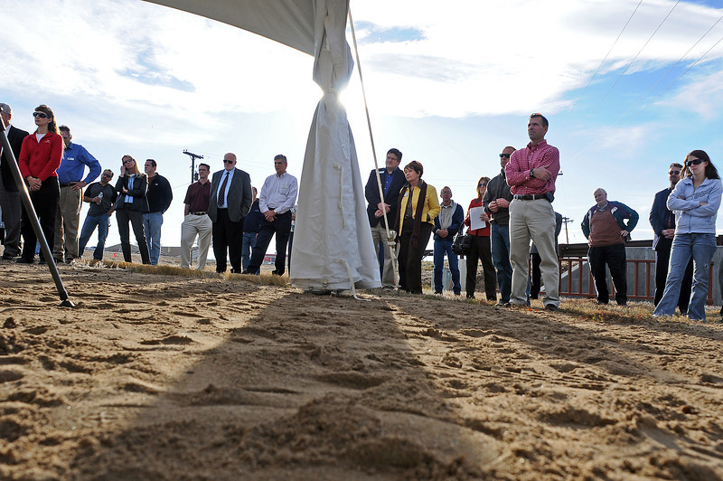 A crowd listens as Mayor Pro Tem Dave Clark talks about the upcoming improvements to the interchange of Interstate 25 and U.S.34 during a groundbreaking ceremony near the site on Tuesday.