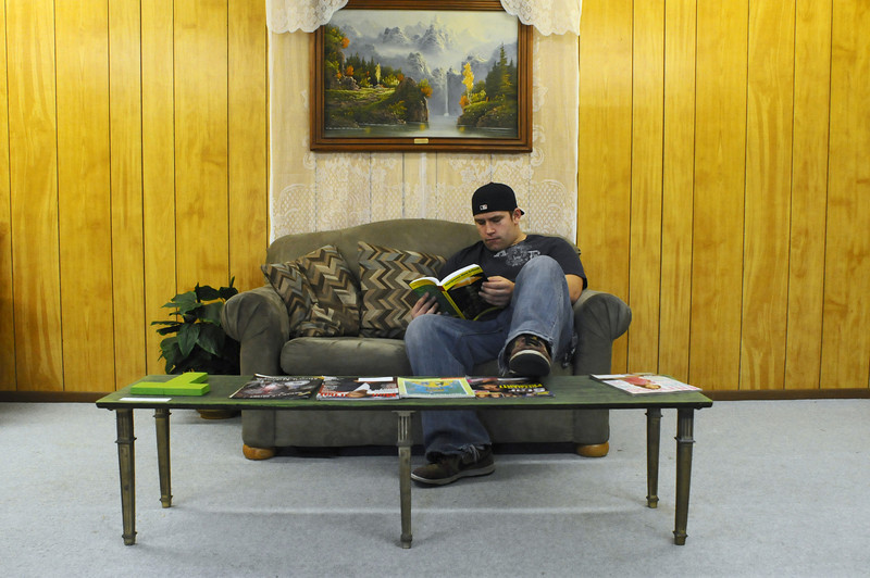 Sebastian Bushey, employee of Merry Janes Wellness Center, hangs out in the waiting area of the medical marijuana dispensary on Thursday.