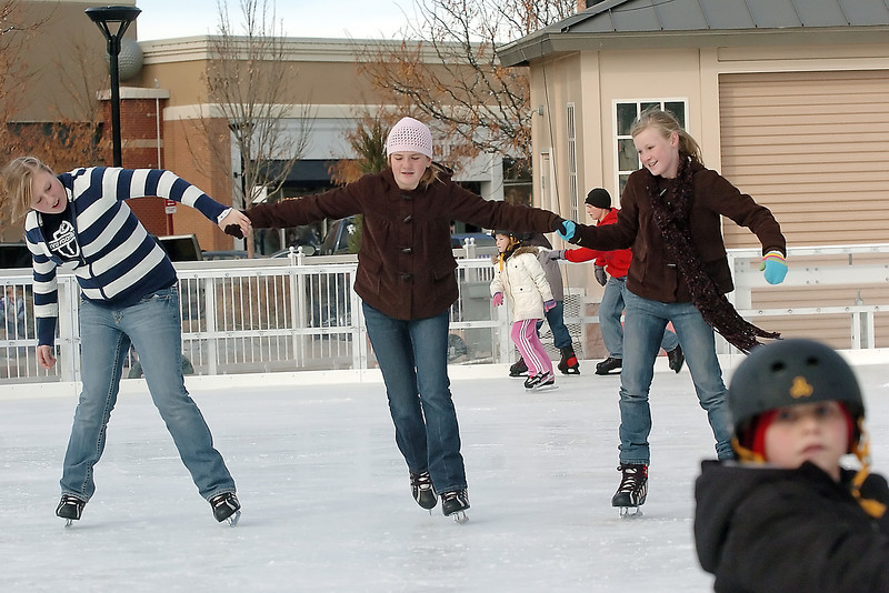 Allison Oligschlaeger, 14, left, Paige Eldridge, 12, and Abby Oligschlaeger, 12, hold hands as they skate around together at The Ice Rink at The Promenade Shops at Centerra on Saturday. The rink is scheduled to be open through Jan. 31 with admission, which includes skate rental, of $5.00 for adults and $3.00 for children. For more on the ice rink call 667-5283.