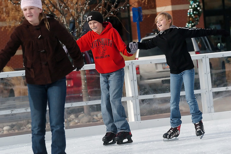 Youngsters make their way around the ice at The Ice Rink at The Promenade Shops at Centerra on Saturday. From left are Paige Eldridge, 12, of Johnstown and Scotsbluff, Neb. residents Blake Wills, 14, and Courtney Wills, 11. The rink is scheduled to be open through Jan. 31 with admission, which includes skate rental, of $5.00 for adults and $3.00 for children. For more on the ice rink call 667-5283.