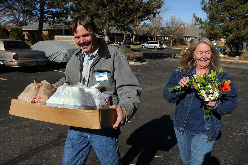 Donna Holtz, right, and Craig Hartig deliver Thanksgiving meals to some of the residents at  Silver Leaf apartments on Thursday.