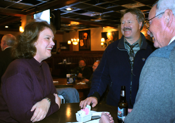 Building a Better Loveland committee member Carol Johnson, left, talks with Alan Krcmarik and Glenn Rousey at the Pourhouse after election results were in. Johnson's group, which supported the Lodging Tax, was rewarded with a win after two other attempts to get the tax passed.