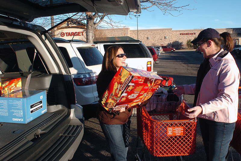 Loveland residents Kim Smith, left, and Shawn Muscott share a laugh as they load their purchases into their vehicle in the parking lot of Target, 1725 Rocky Mountain Ave. while shopping together Friday morning for Christmas presents and other items. Smith, who said she shops on Black Friday every year, picked up first-timer Muscott at 3:45 a.m. to hit the numerous sales looking for bargains.