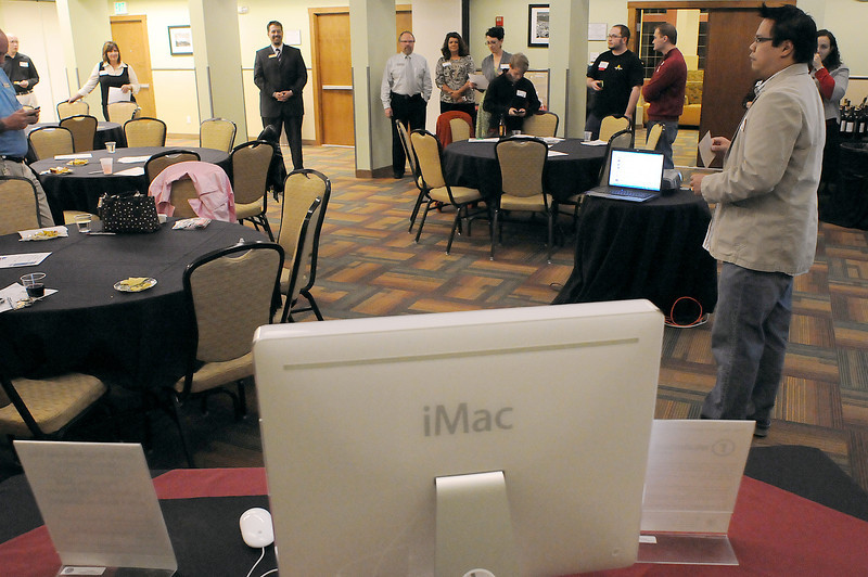 John Metcalf of JM Designs talks with people gathered Thursday night at the Best Western for a meeting of business people interested in using social networking to increase business.