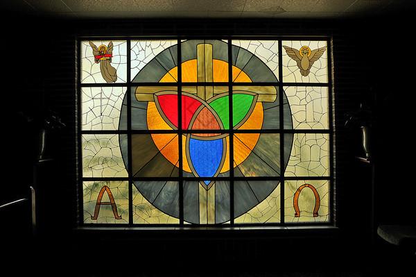Sunlight shines through a window at the First Presbyterian Church of Berthoud.
