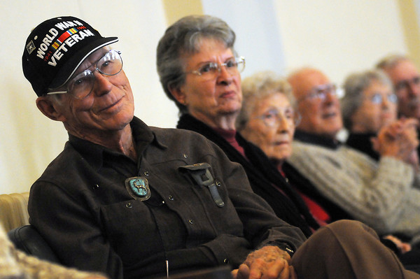 """Tom Buchanan listens as """"Three of Us"""" perform Sunday at the Elks Lodge in downtown Loveland. The concert, which benefits Honor Flight Northern Colorado, raised over $5,000, enough to send at least five veterans to see the World War II Memorial in the nations capital."""