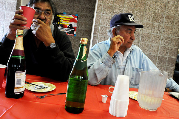 Army veterans Mike Romero, left, and Larry Juvera drink sparkling juice while they wait for Juvera to get a haircut on Tuesday at the Catholic Charities in Fort Collins. About 80 veterans took advantage of the services during the third annual Stand Down event.