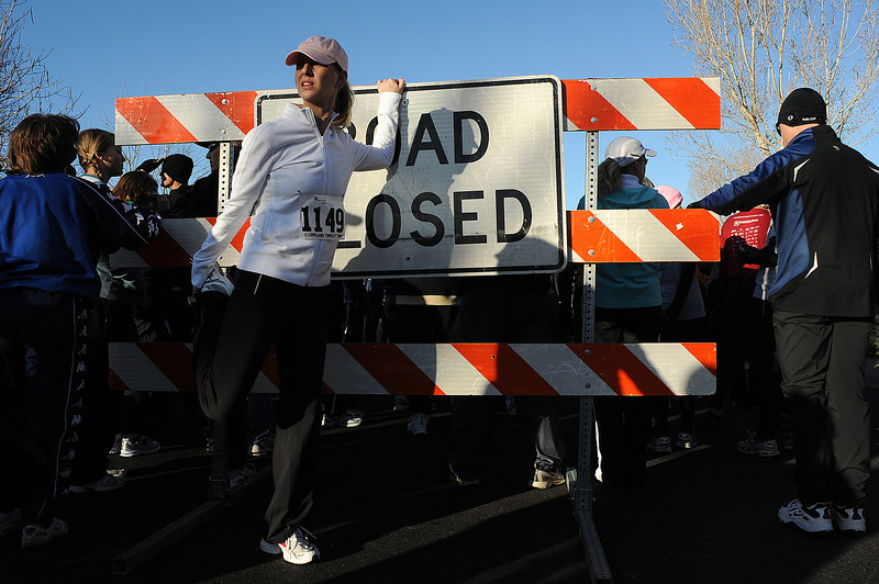 Katie Skinner of Milliken stretches on Thursday before the Loveland Turkey Trot at McKee Medical Center.