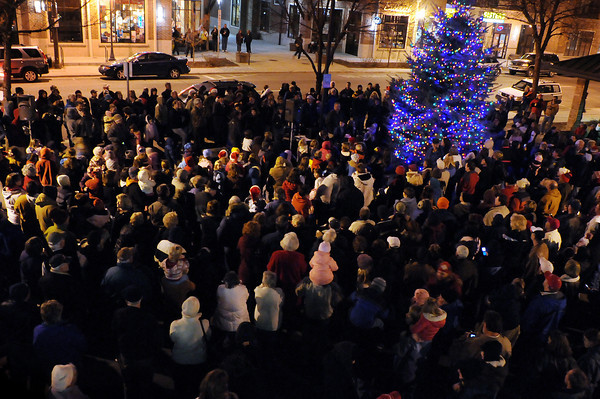 Holiday revelers watch as the City of Loveland's Holiday Tree lights up Sunday during a ceremony at the Loveland Museum/Gallery. About 500 people turned up for the event which was held between the museum and the new Sequel building next door.