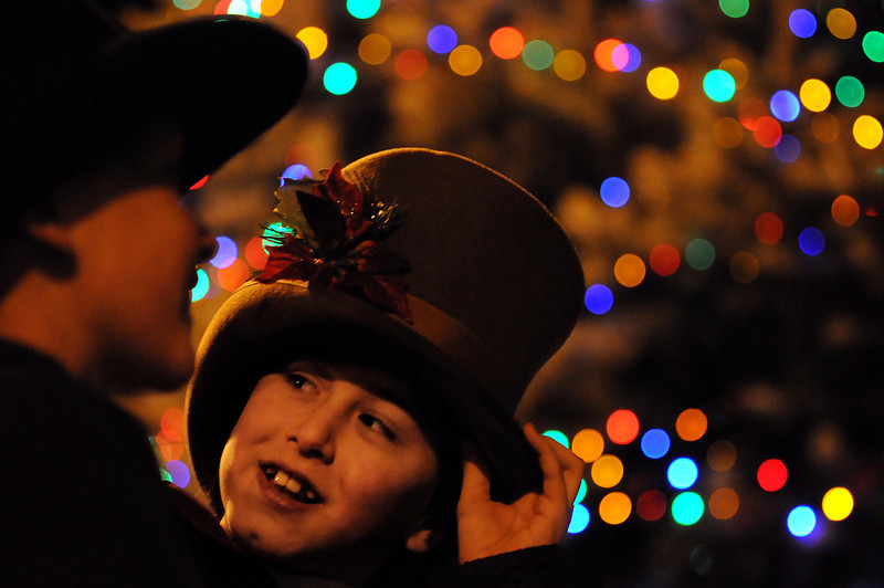 Brian Adams, 9, right, and his friend Josh Moore, 10, of Loveland sing with the Original Dickens Carolers on Sunday during the Holiday Tree Lighting at the Loveland Museum/Gallery.