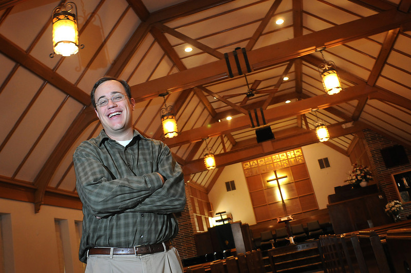 Pastor Scott Phillips poses in the sanctuary of the First Presbyterian Church of Berthoud. The church will celebrate its 125th anniversary Sunday, Nov. 15.