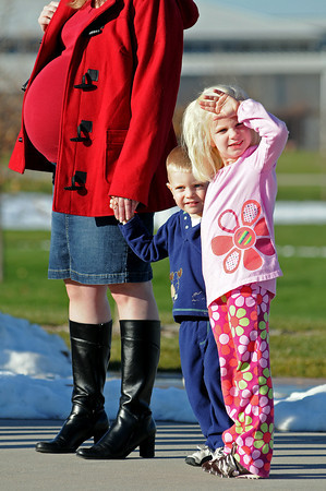 Tyler, 2, and Natalie Hansen, 4, of Fort Collins wait with their mother Kristen Hansen for the doors to open to the first Larimer County H1N1 flu clinic on Wednesday at The Ranch. The children were there to get vaccinations for the H1N1 flu but their mother was unable to get one because there was not enough.