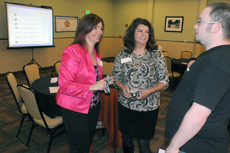 Nick Armstrong, left, talks with Kixie Daly, left, of Dixie Home Services and Lori Gama of DaGama Web Studio during a meeting about social media and business at the Best Western on Thursday.