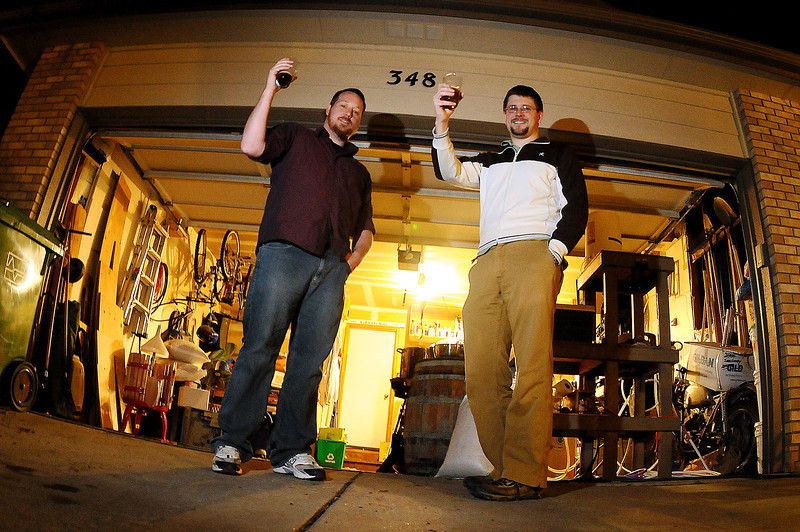 Aaron Heaton, left, and Don Chapman, cofounders of Grimm Brothers Brewhouse, teamed up to brew their German-style beer out of Chapman's garage in Loveland after they won several brewing competitions. The two plan to move the operation out of the garage to a larger building so they can bring Loveland its first brewery and offer their craft beers by early next year.