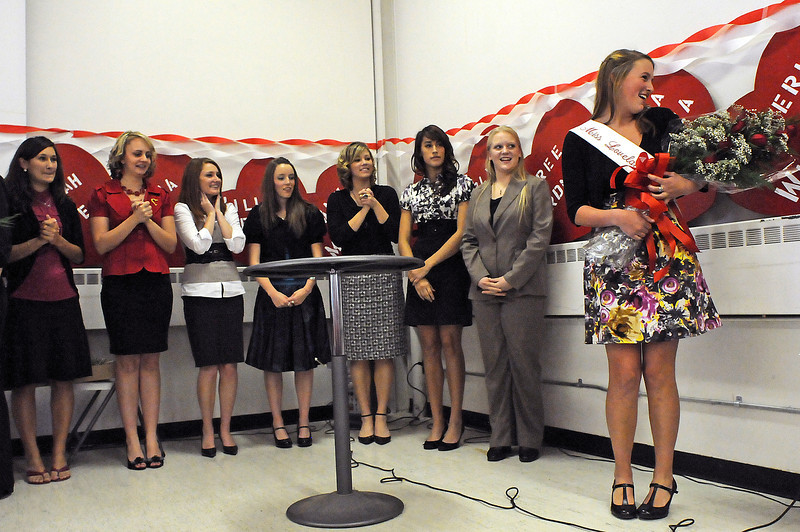 Hillary Skeffington, 17, right, reacts after being chosen Miss Loveland Valentine on Thursday at the former location of Hewlett-Packard at Southeast Third Street and South Jefferson Avenue.