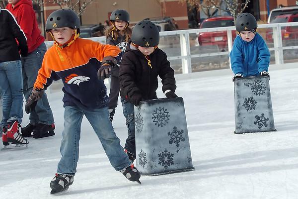 Youngsters make their way around the ice at The Ice Rink at The Promenade Shops at Centerra on Saturday. Front from left are Will Weaver, 8, Drew Wills, 5, and Preston Beal, 5, and at rear from left arfe Courtney Wills, 11, Blake Wills, 14, and Hillary Weaver, 8. The rink is scheduled to be open through Jan. 31 with admission, which includes skate rental, of $5.00 for adults and $3.00 for children. For more on the ice rink call 667-5283.