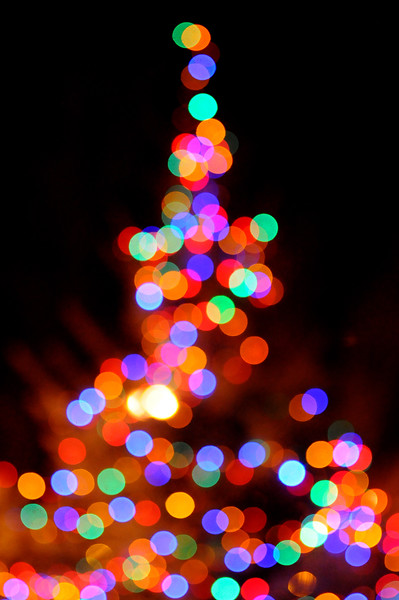 A defocused holiday tree shines its light into Loveland on Sunday during the Holiday Tree Lighting at the Loveland Museum/Gallery.