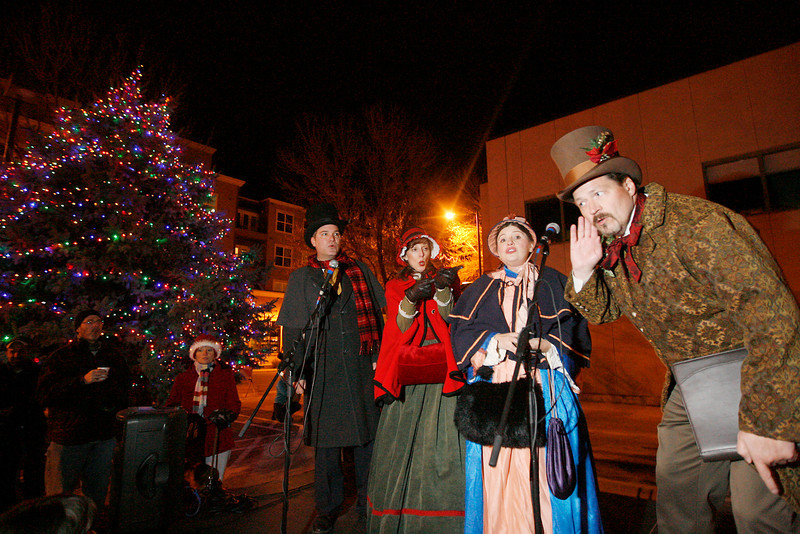 Members of the Original Dickens Carolers, from left, Jim Miller, Kathy Kautz, Susana Brizuela and Robert Hubbard, sing Christmas carols for the crowd during the Loveland Community Tree Lighting sunday night in the Loveland Museum/Gallery parking lot. Photo by Gabriel Christus