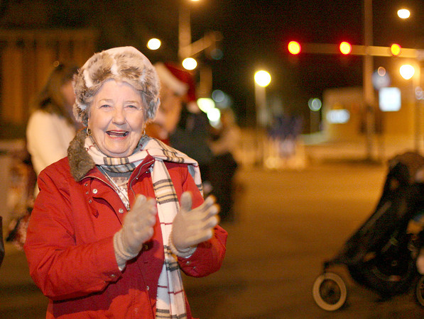 Loveland resident, Shirley Blair, claps her hands during the Loveland Community Tree Lighting sunday night in the Loveland Museum/Gallery parking lot. Photo by Gabriel Christus