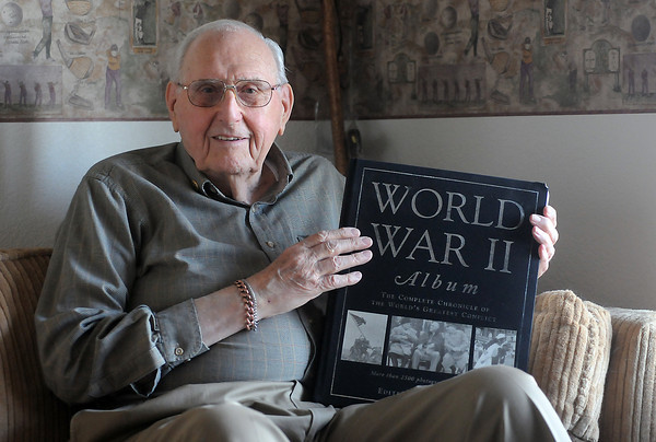 World War II veteran Robert Barnd poses Nov. 20, 2010 in his Loveland home.