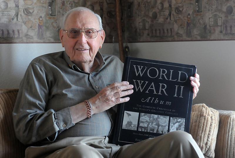 World War II veteran Robert Barnd poses Nov. 20, 2010 in his Loveland home.