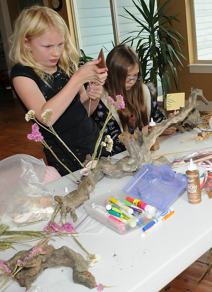 Tasha Reichhardt, 9, left, and Chloe Entner, 10, work on sculptures Saturday at the Environmental Learning Center.