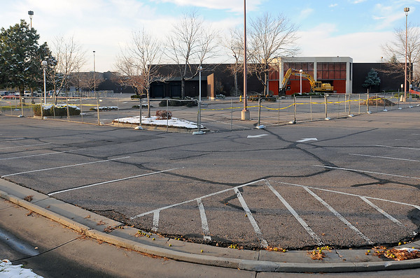 A chain-link fence surrounds the former J.C. Penney location at the Foothills Mall in Fort Collins on Friday.