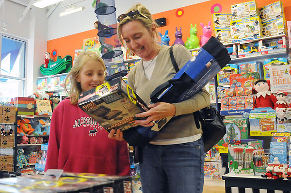 Nine-year-old Anika Florin and her mother, Lisa, look at toys on display while picking out birthday gifts for a friend at Learning Express located in the Front Range Village shopping center in south Fort Collins.