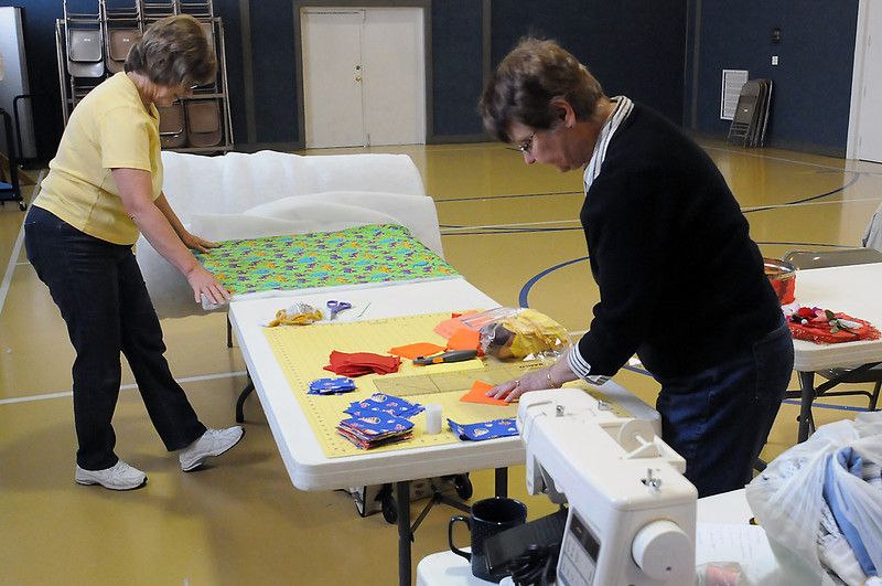 Judy Swens, left, and Shirley Sanders work on quilts last Friday at Loveland Church of the Nazrene that will be donated to premature infants and newborns in need as part of the Warm Hearts/Warm Babies program.