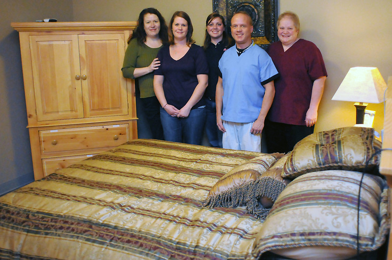 Staff members of the Sleep Disorders Center of the Rockies, located at 1825 E. 18th St., pose Thursday in one of the patient sleep rooms where patients are monitored during overnight stays to diagnose and treat a variety of disorders like sleep apnea. From left are Rebecca Hood, Amber Greenough, Jessie Peach, Troy Morgenstern and Carolyn Odean.