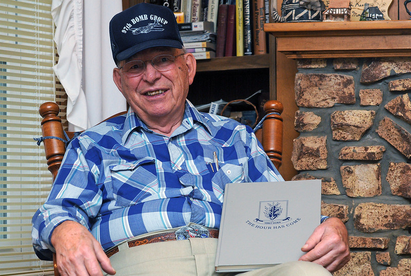 World War II veteran Henry Yekel poses Nov. 18, 2010 in his Loveland home. He flew 30 official missions as a waist gunner in a B-17 with the 340th Bomb Squad, 97th Bomber Group of the 15th Air Force.