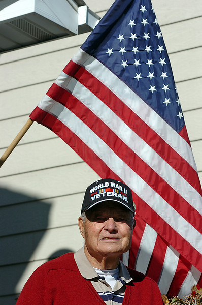 Worl War II veteran Joseph Roberts poses for a photo on the front porch of his Loveland home on Wednesday, November 17.