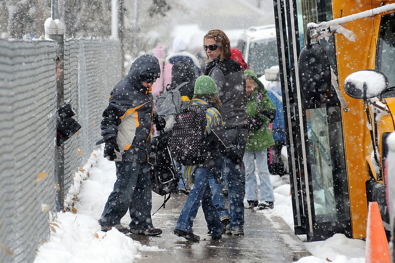 Parents pick up their children at Garfield Elementary on Wednesday afternoon. The Thompson School District kept the schools open and kept to the usual early release  schedule during the storm.