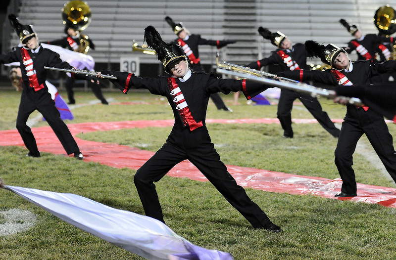 Members of the Loveland High School Crimson Regiment perform during the Northern Regional Band Competition at Thompson Valley High School on Wednesday.